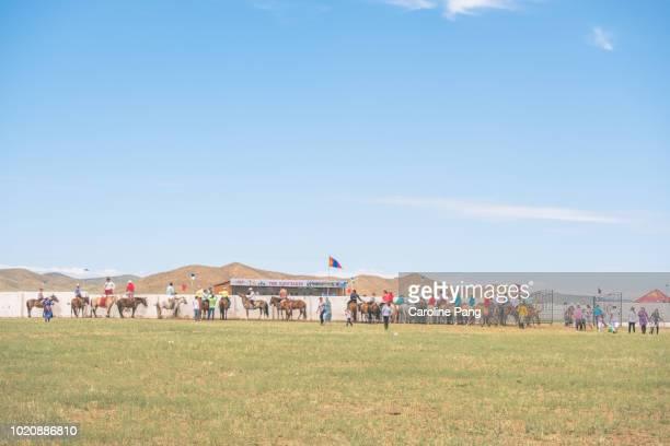 Mongolians spectators at rural Naadam festival.