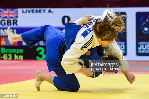 Mongolia's Gankhaich Bold and Britain's Amy Livesey fight during their women's -63kg bronze medal category combat at the Tashkent Grand Slam judo...