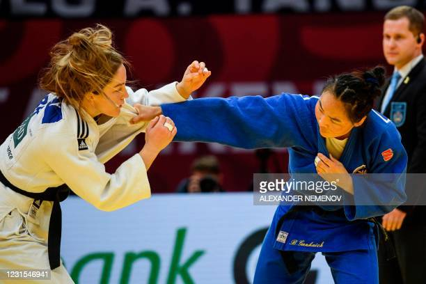 Mongolia's Gankhaich Bold and Britain's Amy Livesey fight during their women's -63kg category combat at the Tashkent Grand Slam judo tournament at...
