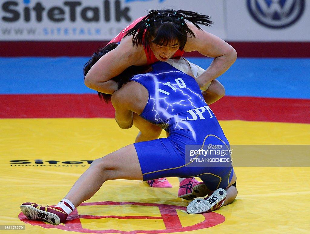 Mongolia's Munkhtuya Tungalag And Japan's Ayaka Ito Fight