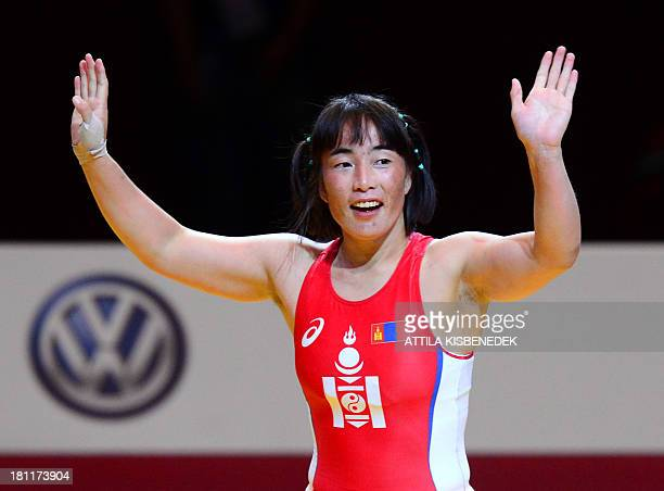 Mongolia's Munkhtuya Tungalag celebrates her victory over Japan's Ayaka Ito after the women's free style 59 kg category for bronze of the FILA World...