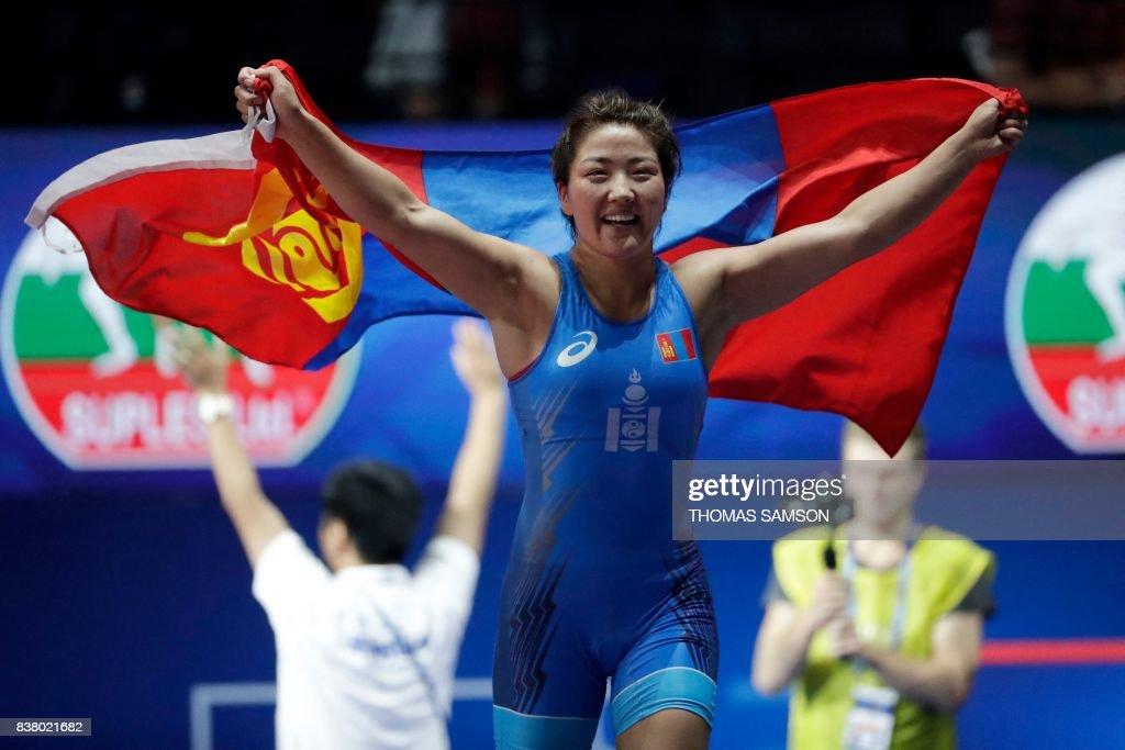 Mongolia's Orkhon Purevdorj celebrates after she won against... News Photo  - Getty Images