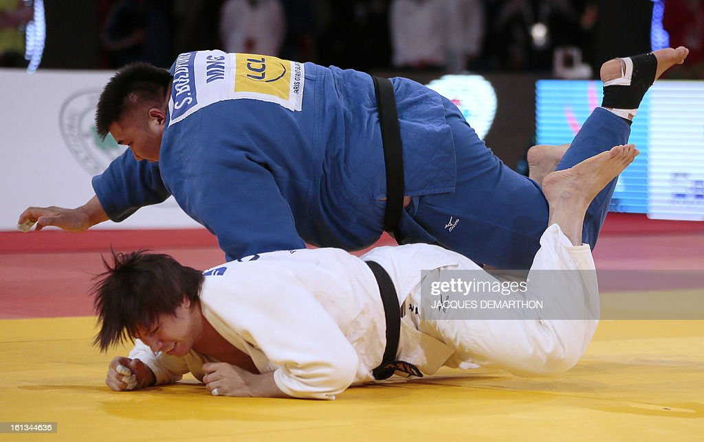 Mongolia's Sugarjargal Boldpurev (Top) competes against Japan's Shichinohe Ryu on February 10, 2013 in the Men's over 100kg category qualifying fight during the Paris International Judo tournament,...
