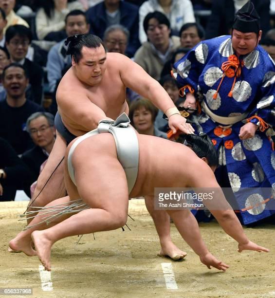 Mongolilan yokozuna Kakuryu throws Mongolian Takanoiwa to win during day seven of the Grand Sumo Spring Tournament at Edion Arena Osaka on March 18...