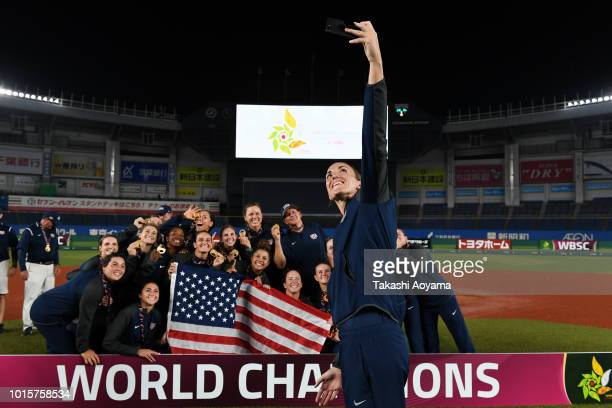 Monica Abbott of United States and team mates celebrate with their gold medal after the awards ceremony at ZOZO Marine Stadium on day eleven of the...