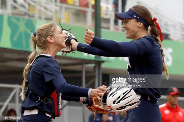 Monica Abbott of United States celebrates with her teammate Aubree Munro after winning the game against Canada during the Softball Women Grand Final...
