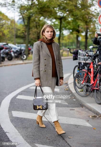 Monica Ainley seen wearing brown hoody and blazer Hermes bag white pants outside Hermes during Paris Fashion Week Womenswear Spring Summer 2021 Day...