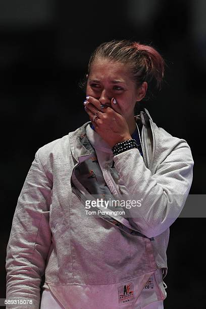 Monica Aksamit of the United States celebrates after the United States wins the Women's Sabre Team bronze medal match between United States and Italy...