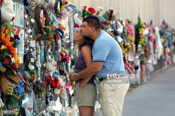 Monica and Barry Wixson visit a wall covered with items left in memory of victims of the Oklahoma City bombing June 11 2001 at the Oklahoma National...