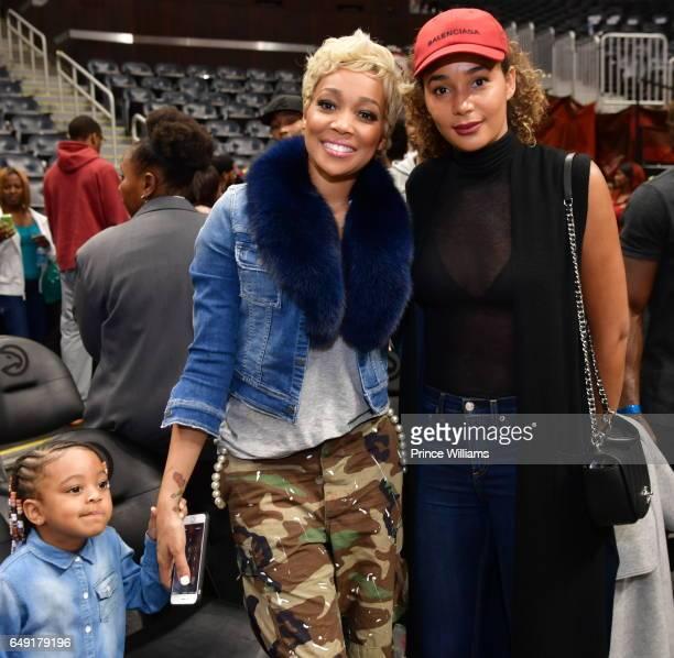 Monica and Bertille Sefolosha attend The Dallas Mavericks Vs Atlanta Hawks Game at Phillips Arena on March 1 2017 in Atlanta Georgia