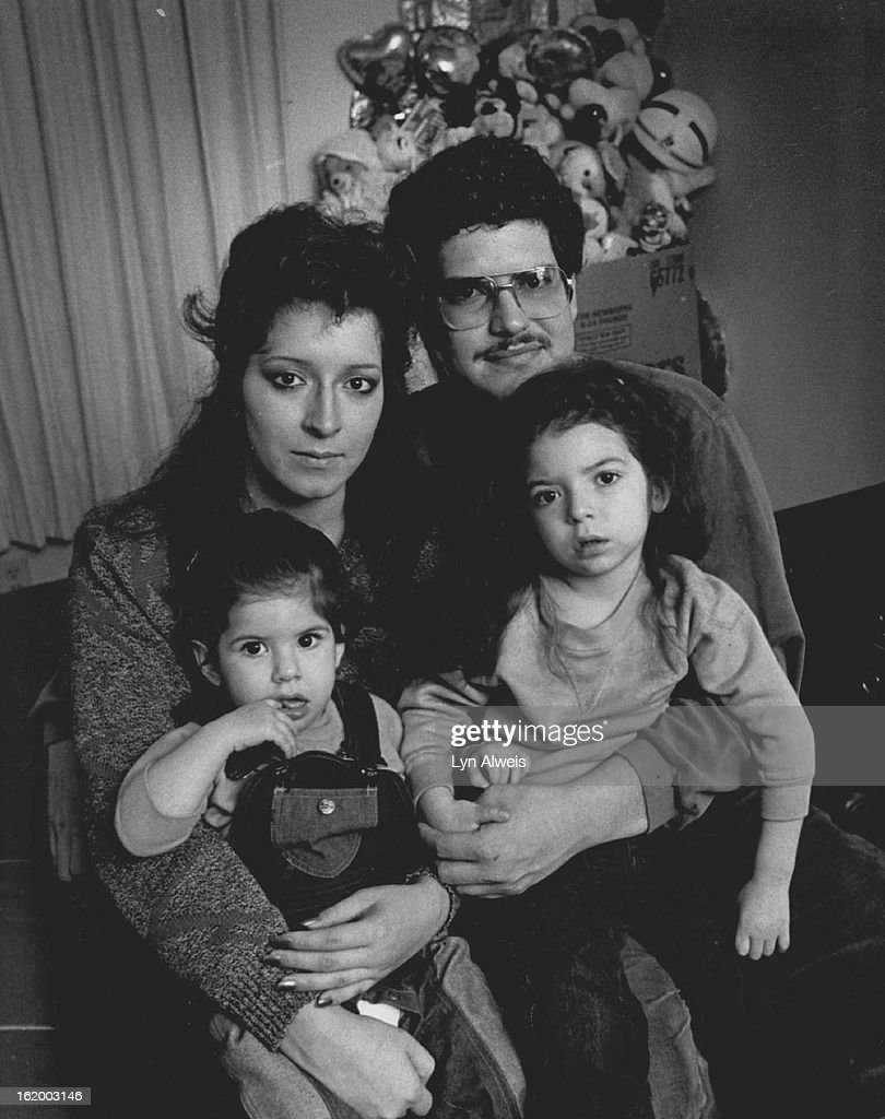 DEC 5 1986; Monica and Robert Jaramillo and their children Chennelle, 1 and Rechelle, 3 in their Chi : News Photo