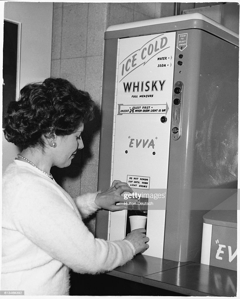 woman buys whisky and soda from machine pictures getty images