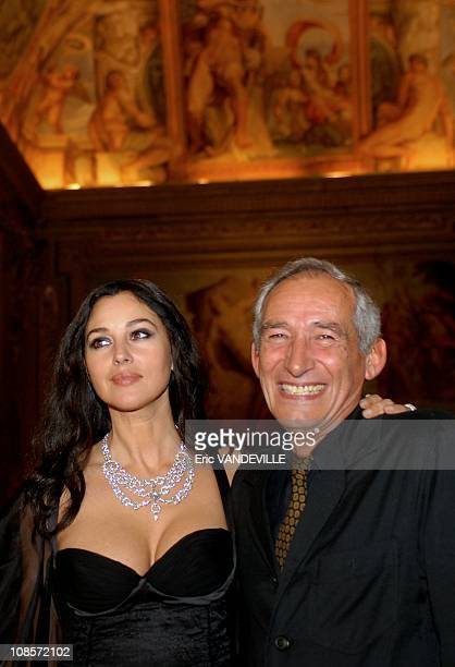 Monica Bellucci and french director Alain Corneau in Rome Italy on October 18 2007 Party held at Palazzo Farnese the french Embassy in Rome in honor...
