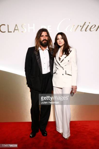 Monica Bellucci and her companion Nicolas Lefebvre attend the Clash De Cartier Launch Photocall At La Conciergerie In Paris on April 10 2019 in Paris...