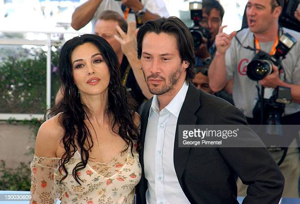 Monica Bellucci and Keanu Reeves during 2003 Cannes Film Festival Matrix Reloaded Photo Call at Palais des Festivals in Cannes France