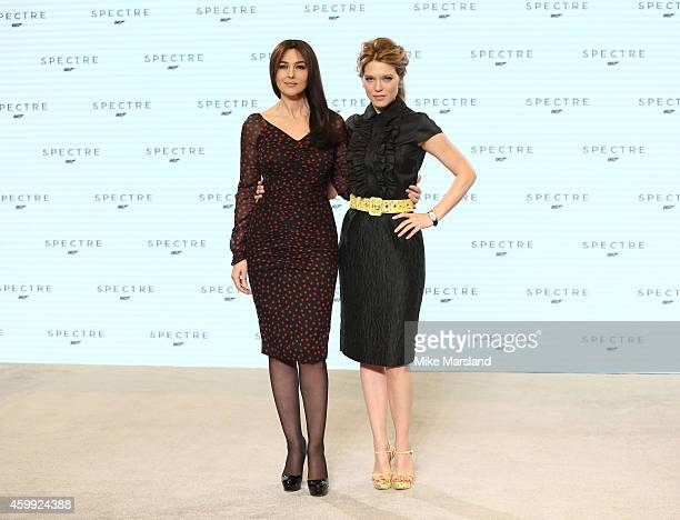 Monica Bellucci and Lea Seydoux attend a photocall for Bond 24 at Pinewood Studios on December 4 2014 in Iver Heath England
