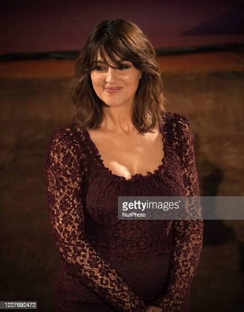 Monica Bellucci attend the ceremony in memory of Ennio Morricone in the suggestive ancient theater of Taormina with the presentation of the film by...