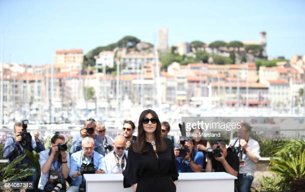 Monica Bellucci attends a photocall for her duty as Mistress of Ceremonies during the 70th annual Cannes Film Festival at Palais des Festivals on May...