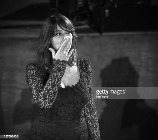 Monica Bellucci attends the ceremony in memory of Ennio Morricone in the suggestive ancient theater of Taormina with the presentation of the film by...