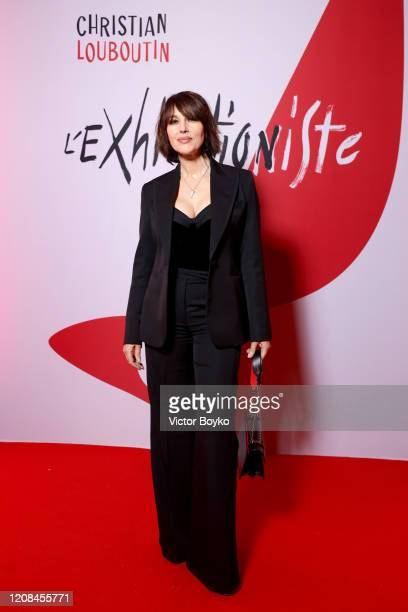 Monica Bellucci attends the Exhibition Opening of L'Exibition[niste] by Christian Louboutin as part of Paris Fashion Week Womenswear Fall/Winter...