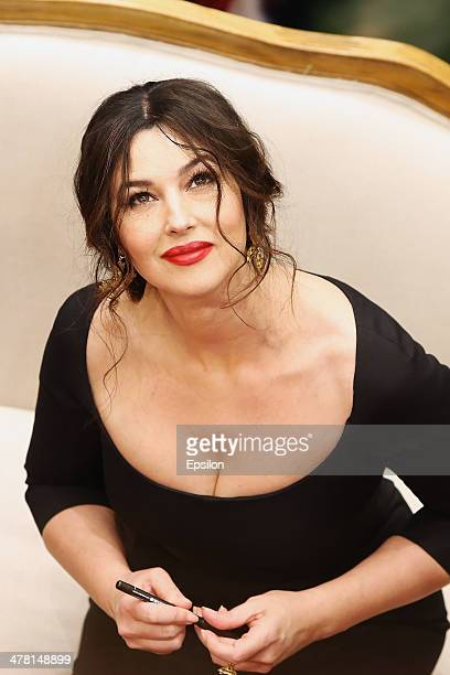 Monica Bellucci attends the photocall at Dolce Gabbana shop at TSUM on March 12 2014 in Moscow Russia