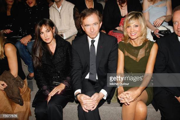 Monica Bellucci Bernard Arnaut and Helene Arnaut attend the Christian Dior Fashion Show as part of Paris Fashion Week Spring/Summer 2007 on October 3...