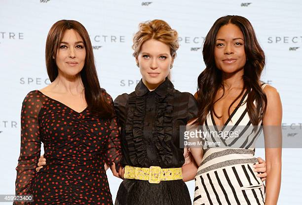 Monica Bellucci Lea Seydoux and Naomie Harris attend a photocall with cast and filmmakers to mark the start of production which is due to commence on...