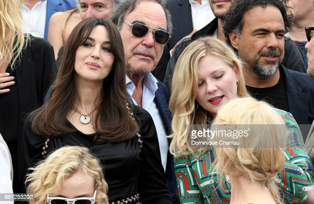 Monica Bellucci Oliver Stone Kirsten Dunst and Alejandro Gonzalez Inarritu attends the 70th Anniversary photocall during the 70th annual Cannes Film...