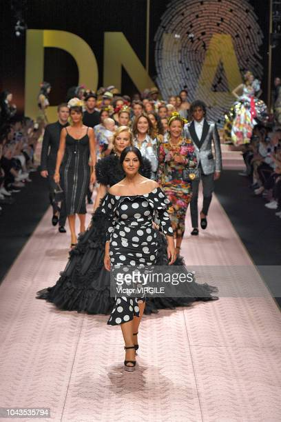 Monica Bellucci walks the runway at the Dolce Gabbana Ready to Wear fashion show during Milan Fashion Week Spring/Summer 2019 on September 23 2018 in...