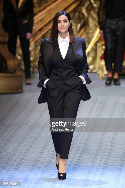 Monica Bellucci walks the runway at the Dolce & Gabbana show during Milan Men's Fashion Week Spring/Summer 2019 on June 16, 2018 in Milan, Italy.
