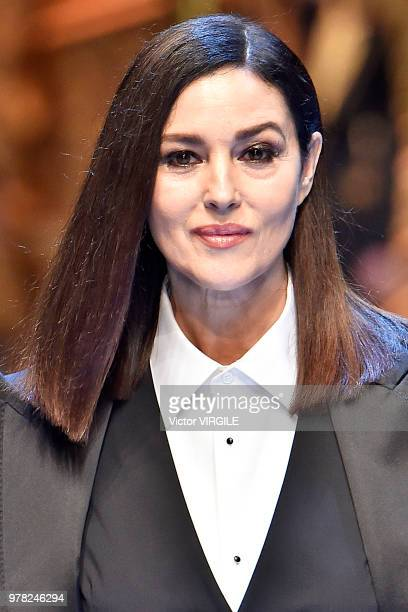 Monica Bellucci walks the runway at the Dolce Gabbana show during Milan Men's Fashion Week Spring/Summer 2019 on June 16 2018 in Milan Italy