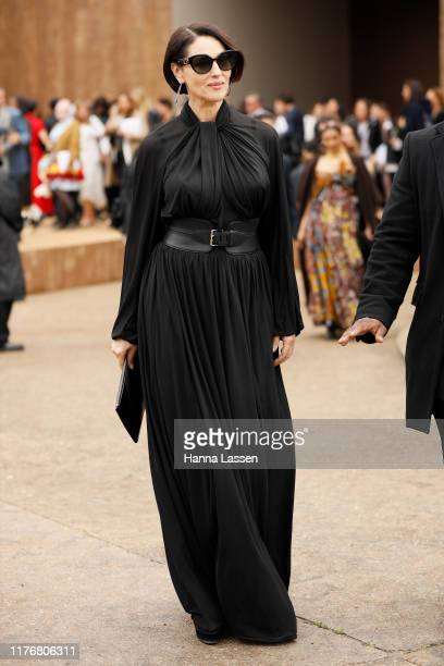 Monica Bellucci wearing black sheer maxi dress outside Dior on September 24, 2019 in Paris, France.