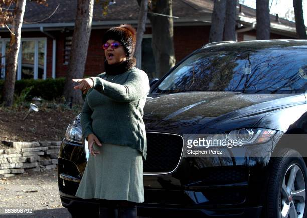 Monica Conyers wife of embattled Michigan Rep John Conyers tells the media to move their equipment from the Congressman's home on December 1 2017 in...