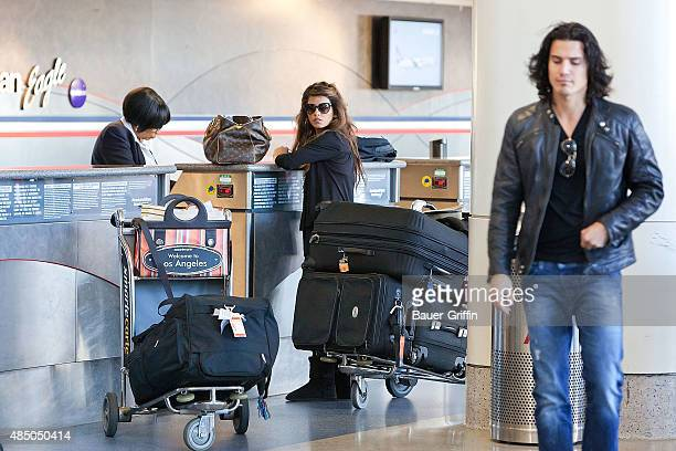 Monica Cruz and Alex Gonzalez are seen at Los Angeles International Airport on March 13 2011 in Los Angeles California