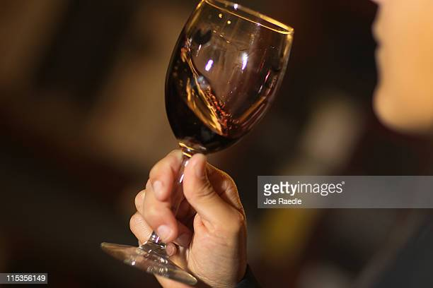 Monica De Abreu tastes a red wine as she decides which wines to purchase to sell at Global Liquors store on June 6 2011 in Miami Florida Reports...