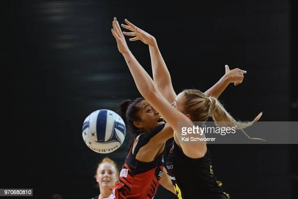 Monica Falkner of the Magic is challenged by Temalisi Fakahokotau of the Tactix during the round six ANZ Premiership match between the Mainland...