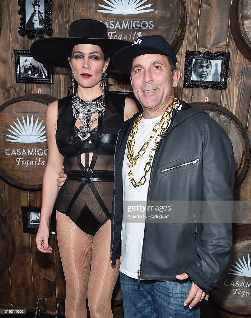 Monica Gambe and Discovery Land Company CEO Mike Meldman arrive to the Casamigos Halloween Party at a private residence on October 28, 2016 in Beverly Hills, California.