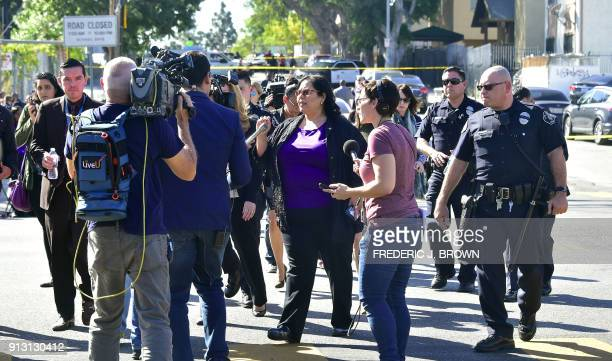 Monica Garcia from LAUSD's Board of Education is surrounded by media while crossing the street outside a roadblock near Salvadore Castro Middle...