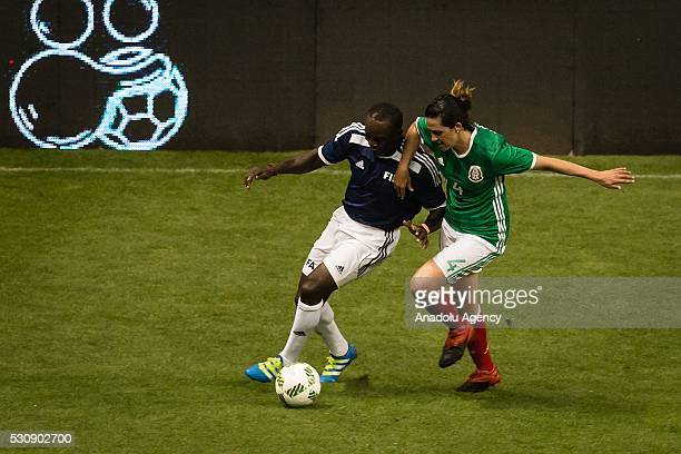 Monica Gonzalez of Mexican allstar team in action against Dwight Yorke of FIFA Football Legends team during a friendly match between Mexican allstar...