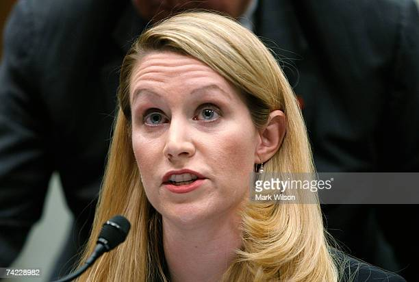 Monica Goodling former Justice Department White House Liaison exchages papers with a committee staffer during a House Judiciary Committee hearing on...