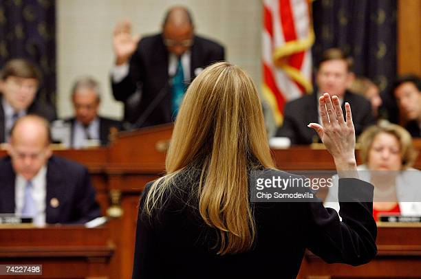 Monica Goodling former Justice Department White House liaison takes the oath to tell the truth before she testifies to the House Judiciary Committee...