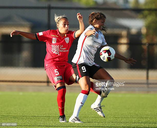 Monica Hickmann Alves of Adelaide United competes for the ball with Katherine Stengel of Western Sydney during the round 12 WLeague match between...