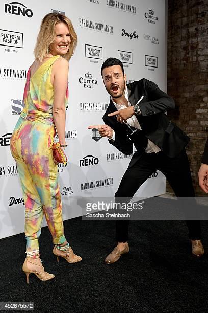 Monica Ivancan and Giovanni Zarella joke prior the Barbara Schwarzer show during Platform Fashion Dusseldorf on July 25 2014 in Duesseldorf Germany