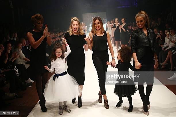 Monica Ivancan and Jana Ina Zarrella walk the runway at the GAB&TY show as part of Platform Fashion Selected during Platform Fashion January 2016 at...