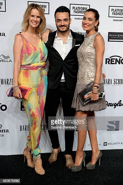Monica Ivancan, Giovanni Zarella and Jana Ina Zarrella pose prior the Barbara Schwarzer show during Platform Fashion Dusseldorf on July 25, 2014 in...