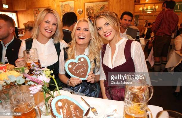 Monica Ivancan Jennifer Knaeble and Viviane Geppert during the 'Fruehstueck bei Tiffany' at Schuetzenfestzelt at the Oktoberfest on September 22 2018...