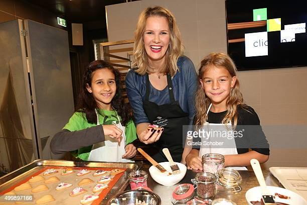 Monica Ivancan prepares cookies with children during the World Childhood Foundation Baking at Hotel Vier Jahreszeiten on November 30 2015 in Munich...