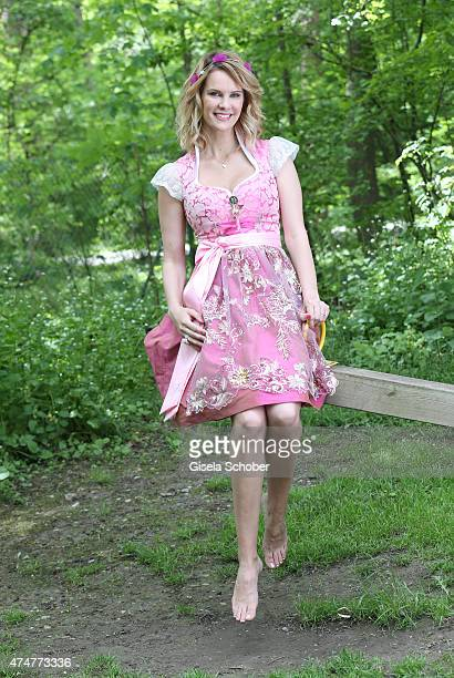 Monica Ivancan wearing a dirndl by Astrid Soell hair accesssoires by 'Schoenmich' jewellery by 'sweet deluxe' poses during a photo session on May 11...