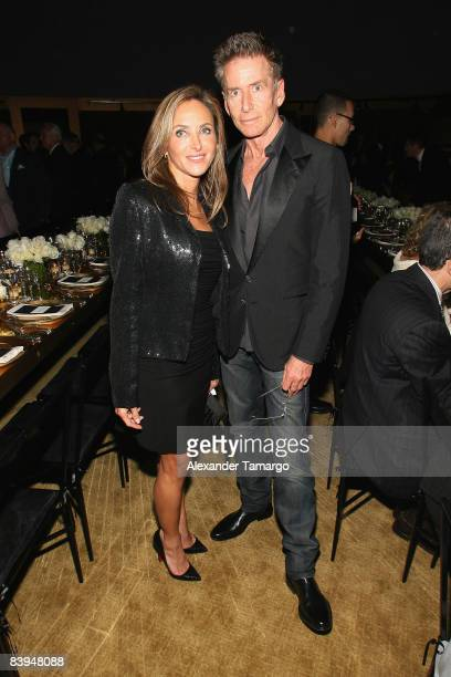 Monica Kalpakian and designer Calvin Klein attend a private dinner in honor of Anri Sala at the Cartier Dome Miami Beach Botanical Garden on December...