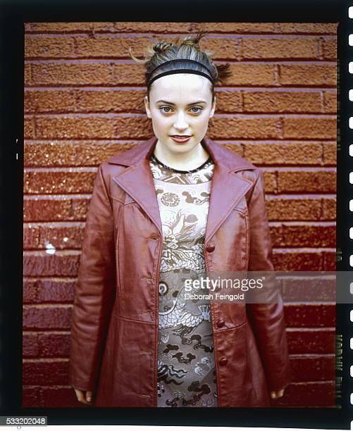 Monica Keena near a Brick Wall